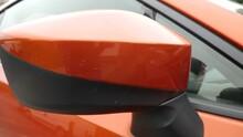 Flashy Red GT Toyota Car Left Mirror Sliding Shot Closeup