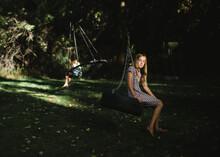 Portrait Of Teenage Girl Sitting On Swing