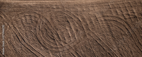 Field plowed with tractor tracks, top view Fotobehang