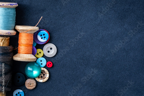 Fotografie, Obraz Heart made of retro thread spools and bright sewing buttons with copy space