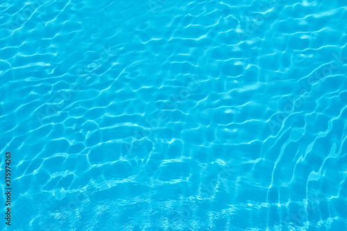 Papel de parede Pure water with ripples in swimming pool