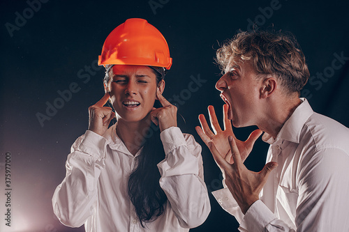 The attractive angry couple fighting and shouting at each other Canvas Print