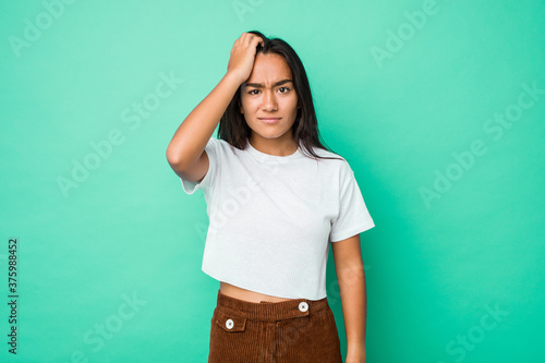 Obraz Young mixed race indian woman isolated tired and very sleepy keeping hand on head. - fototapety do salonu