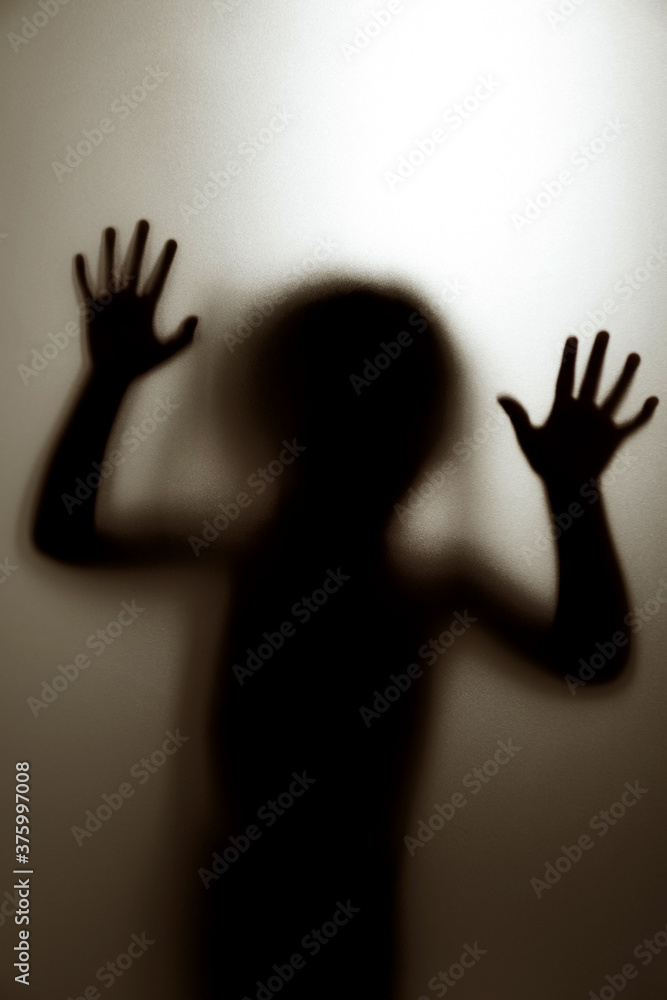 Fototapeta Ghost concept shadow of a child behind the matte glass blurry hand and body soft focus.