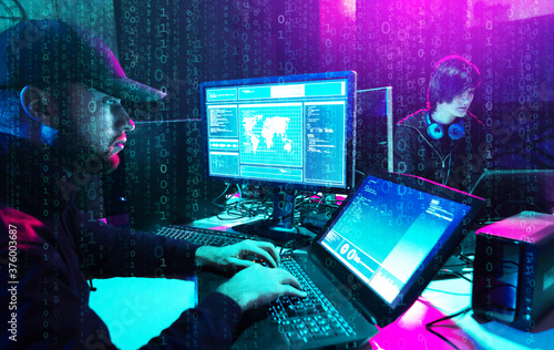 Hackers are breaking server using computers. Cybercrime concept. Fototapet