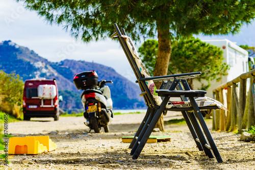 Fototapeta Camp chairs and vehicles on sea shore