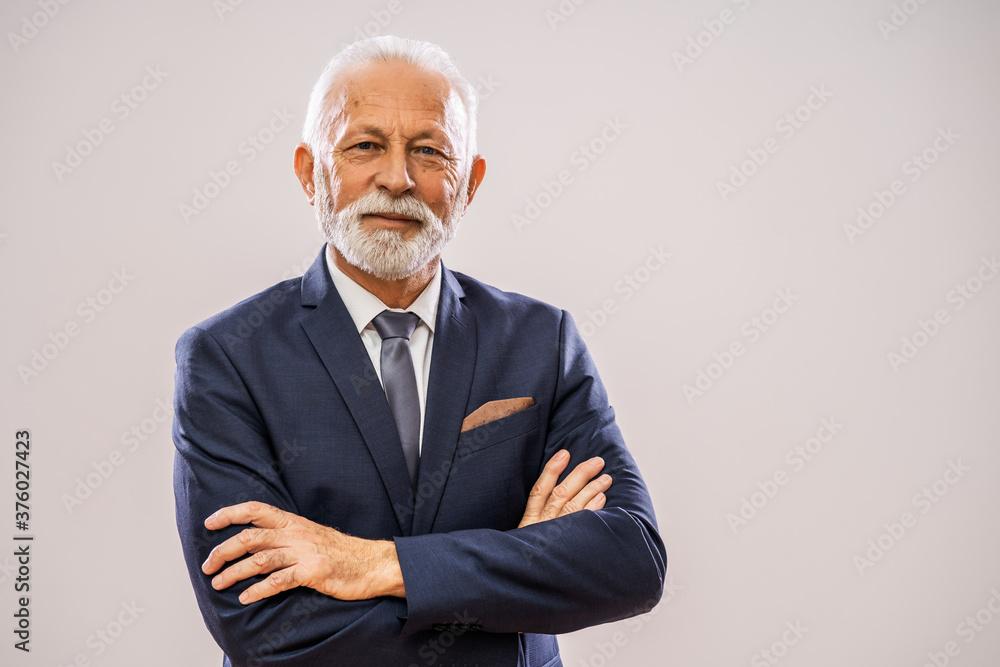 Fototapeta Portrait of happy and successful senior businessman.