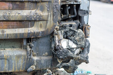 Fully Burnt Truck Close Up. Rusty Truck Charred From Fire. Burnt Car On The Side Of The Road.