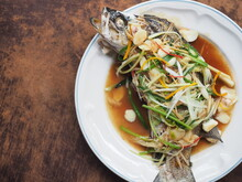 Asian Style Steamed Sea Bass Fish In Soy Sauce