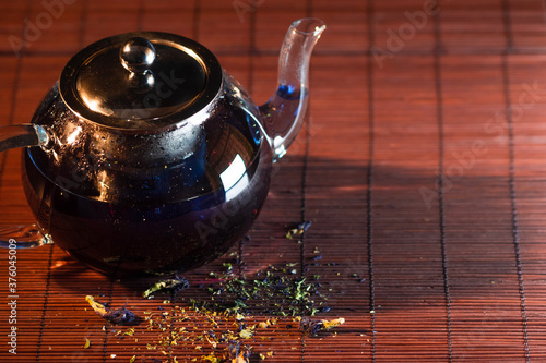 Blue Thai tea in a glass teapot Canvas Print