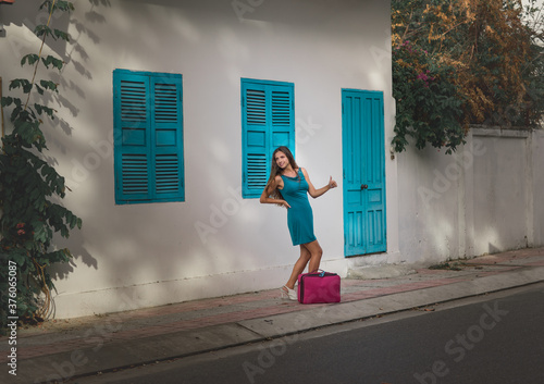 young woman walking on the street #376065087