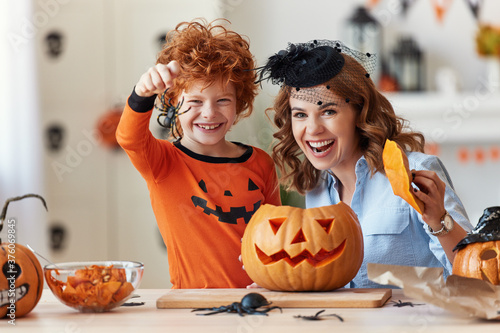 Cuadros en Lienzo happy family mother and son laughing and making scary faces during Halloween celebration