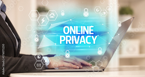 Photo ONLINE PRIVACY inscription on laptop, internet security and data protection conc