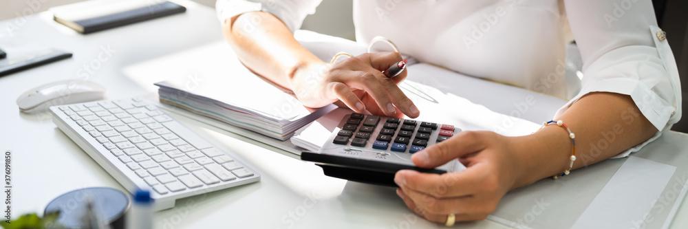 Fototapeta Lady Calculating Invoice. Chartered Accountant