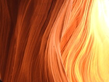 Golden Hues Due To Reflected Light In Lower Antelope Canyon. Waves In The Sandstone Carved By Nature.