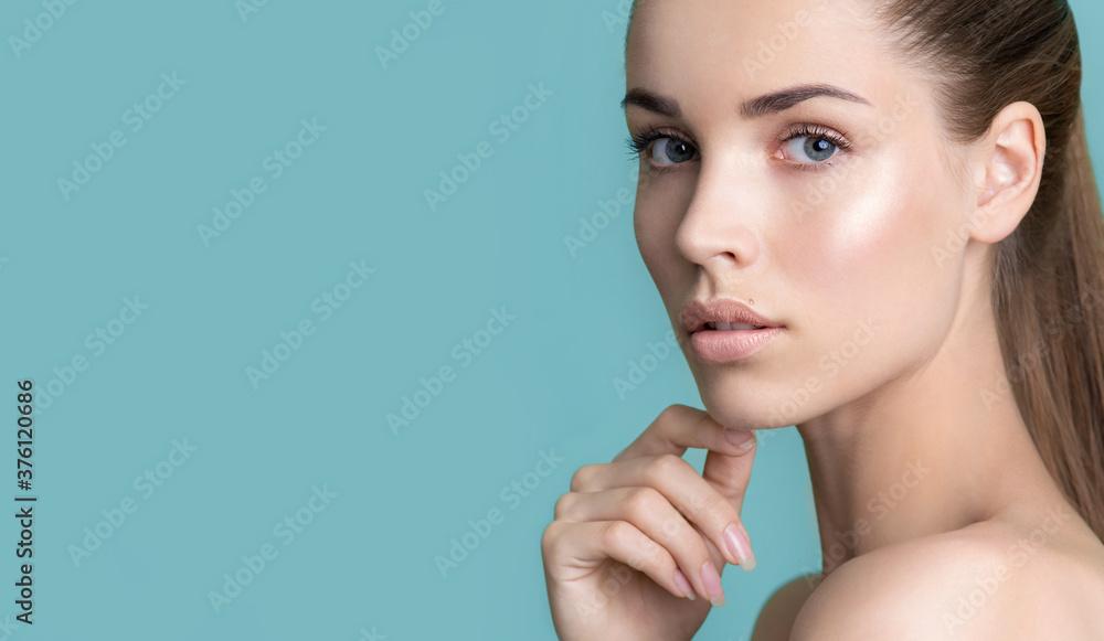 Fototapeta Beautiful young woman with clean perfect skin.