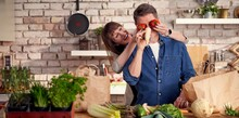 Happy Couple In The Kitchen Un...