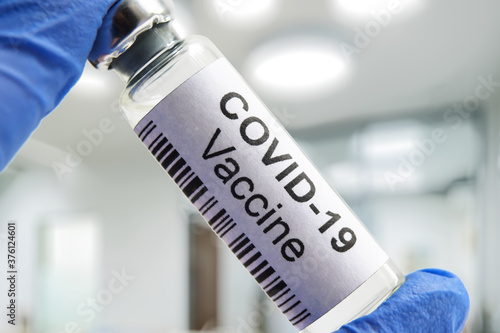 Fototapety, obrazy: COVID-19 coronavirus vaccine in laboratory, medication bottle for SARS-CoV-2 corona virus cure.