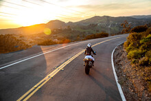 Motorcycle Rider At Sunset Wit...