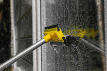 Woman Cleaner Wiping Window Gl...