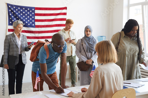 Large multi-ethnic group of people registering at polling station decorated with Wallpaper Mural