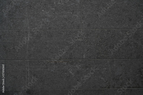 Fotografia Dark Black Stone Texture in outdoor exterior with repeating pattern texture with