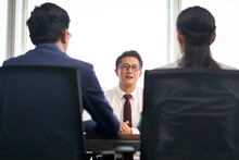 Mature Asian Man Being Interviewed By Young Hr Interviewers