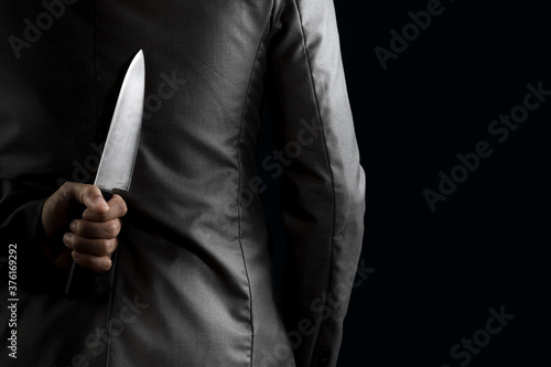 Fotomural businessman hide knife behind back