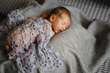 Newborn Baby Boy Sleeping On P...