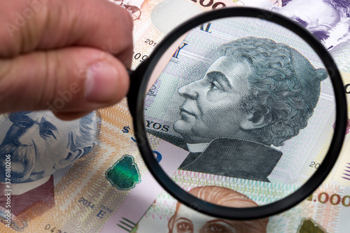 Uruguayan money in a magnifying glass a business background Billede på lærred