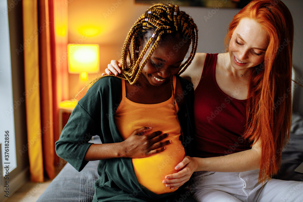 Fototapeta mixed race couple awaiting a baby in room