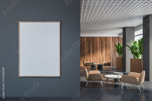 Fototapeta Gray and wooden office lounge with poster