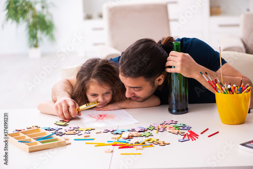 Drunk father and little girl indoors Canvas Print