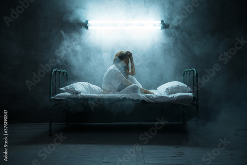 Canvastavla Depressed psycho woman sitting in bed, insomnia