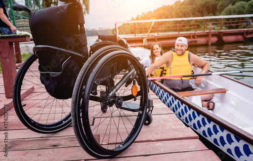 People with disabilities sail on a rowing boat. Canvas