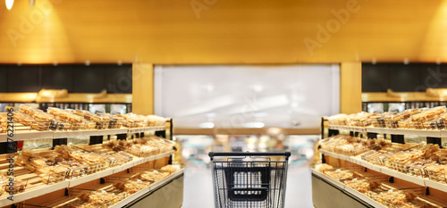 Photo Choosing food from shelf in supermarket,bakery,Grocery stores