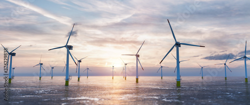 Fotografie, Tablou Offshore wind power and energy farm with many wind turbines on the ocean