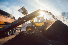 Heavy Machinery Moving Earth A...