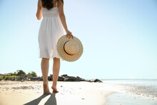 Young Woman With Hat Walking On Beach Near Sea, Closeup. Space For Text