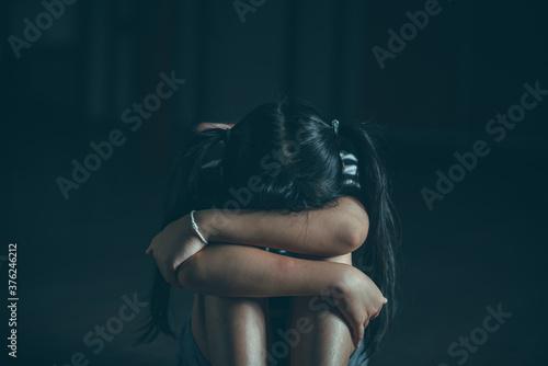 Sad little child girl sitting alone on floor Canvas Print