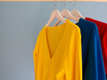 Colourful Cardigans On A Clothes Rail