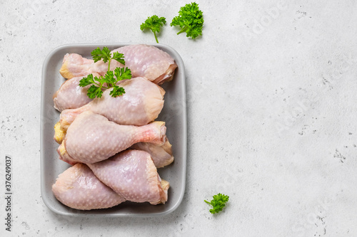 Obraz na plátně Raw chicken legs with spices, mustrad, parsley
