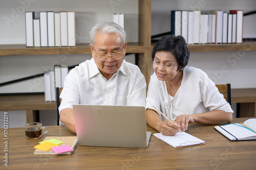 Stampa su Tela A happy senior Asian couple is spending time on surfing  the internet and talking with family on webcam,  retirement concept
