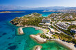 canvas print picture - Aerial view of the crystal clear waters of the Cretan sea and Mirabello gulf (Agios Nikolaos, Crete, Greece)