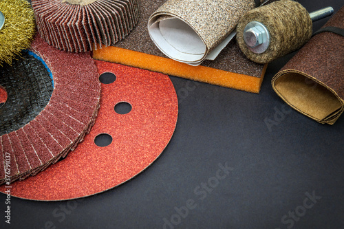Big set of abrasive tools and multicolored sandpaper on black background, wizard Canvas Print