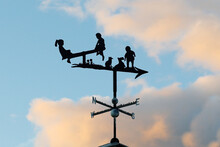 Ancient Weathervane With Child...