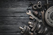 A car gearbox spare parts and wrenches on black background with copy space.