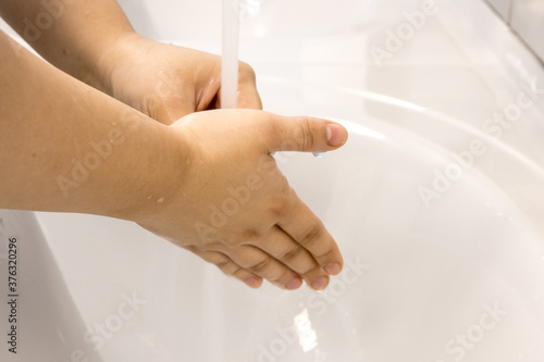 Fototapety, obrazy: Washing your hands with water under the tap