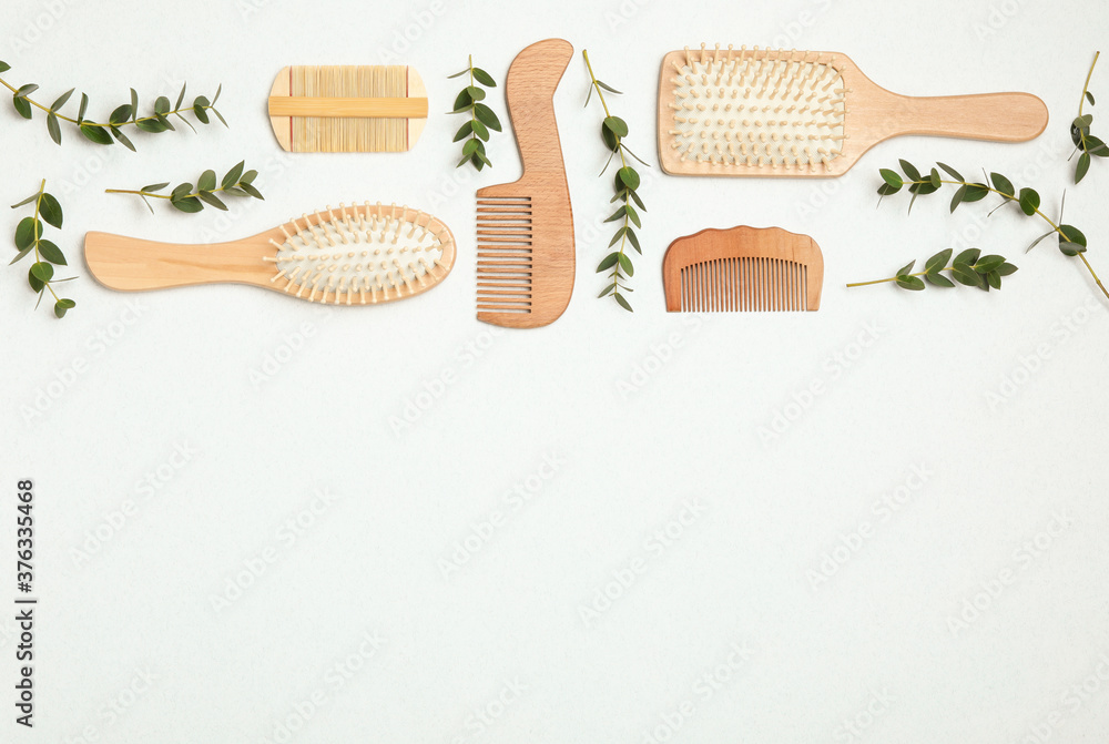 Fotografie, Obraz Flat lay composition with modern hair combs and brushes on white background