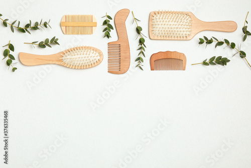Obraz na plátně Flat lay composition with modern hair combs and brushes on white background